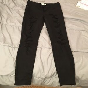 Black destroyed low-rise skinny ankle jeans